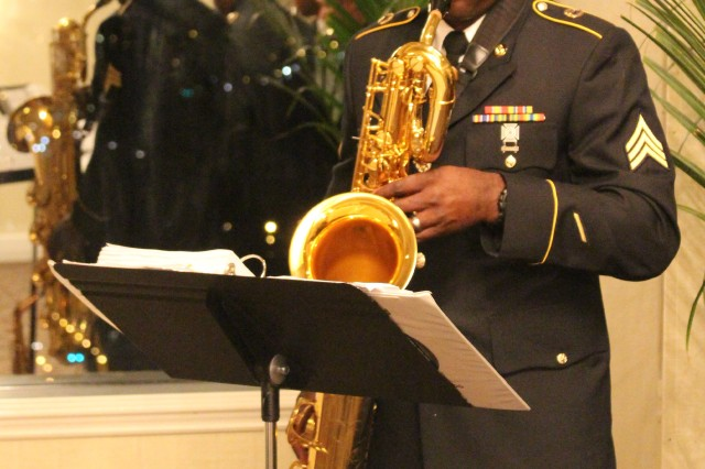 The Capital City Club of Columbia hosted its seventh annual Veterans Day Dinner Celebration on November 11, 2014. Pictured here is Sgt. Gary Rodgers from the 208th Army Band , the band performed during the Tribute to Veterans. U.S. Army photo by Staff Sgt. Toshiko Gregg, 81st Regional Support Command Public Affairs.