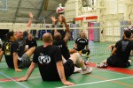 Confident mens sitting volleyball team ready to compete
