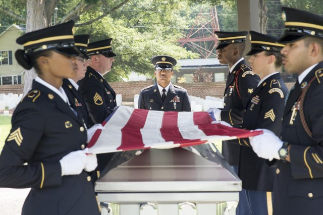 Soldiers with the North Carolina National Guard's Military Funeral Honors fold an American flag during a practice funeral service in Raleigh, N.C., Sept. 4, 2014. Last year, the NCARNG MFH program provided honors for 3,422 veterans who were current or former members of the military. (U.S. Army National Guard Photo by Staff Sgt. Mary Junell / Released)