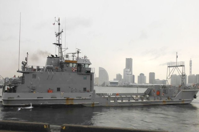 The U.S. Army Vessel Contreras (LCU 2015) and her crew from the 97th Transportation Company, Fort Eustis, Va., pull away from Yokohama North Dock, Japan, enroute to Naha Port, Okinawa, as part of PULSE-W II.