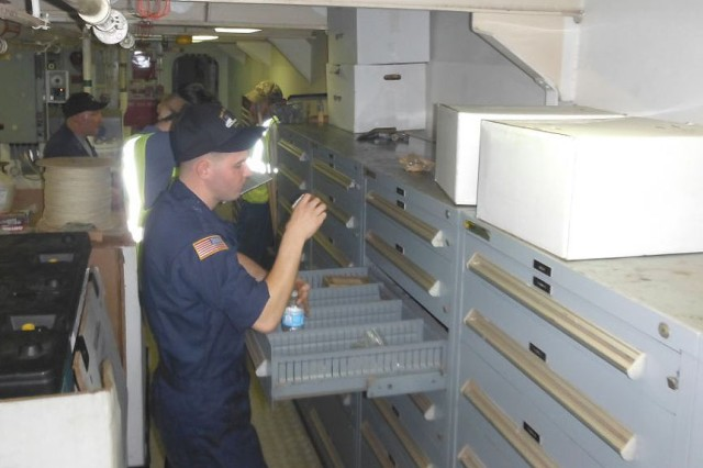 Crew members from the 97th Transportation Company, Fort Eustis, Va., and contractors from Maersk Lines Limited perform Joint Inventories in the engine room aboard the U.S. Army Vessel Contreras (LCU 2015).