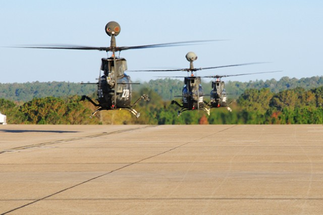 The last three OH-58D Kiowa Warriors fly off the flight line at Hanchey Army Airfield Nov. 18 as they leave Fort Rucker.