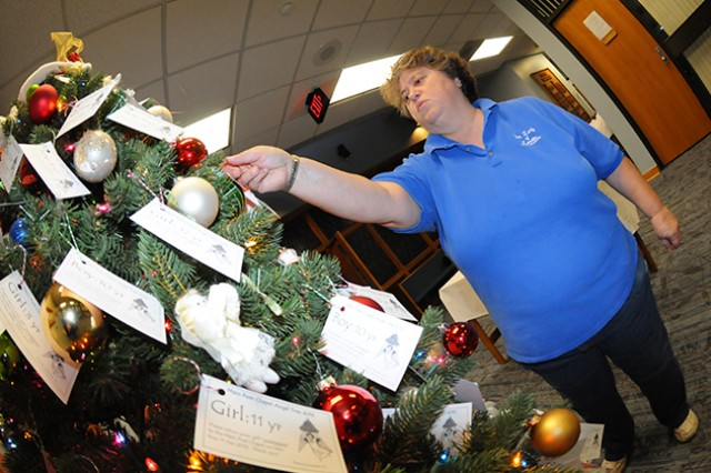 Nancy Jankoski, church community member, takes two tags from last year's Angel Tree. The chapel is again running the Angel Tree program with trees at the Fort Rucker Main Post Chapel and the post exchange.