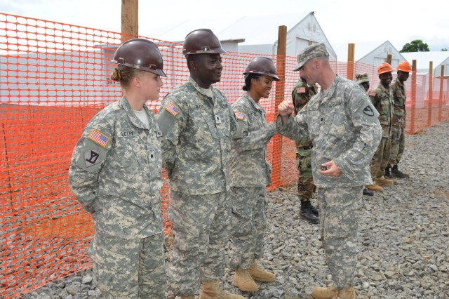 Soldiers, left, of the 62nd Battalion, 36th Engineer Brigade, from Fort Hood
