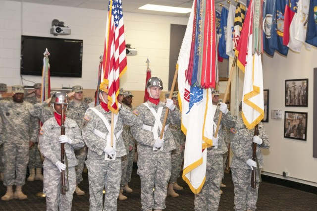 The color guard salutes during the national anthem during the 926th Engineer Brigade change of command ceremony Nov. 23 at the Maj. David Moniac U.S. Army Reserve Center in Montgomery, Ala. (U.S. Army photo by Staff Sgt. Debralee Best)