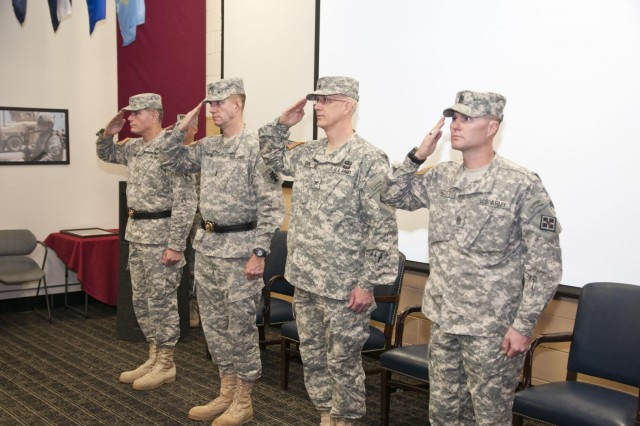 The official party salutes during the national anthem at the 926th Engineer Brigade change of command ceremony Nov. 23 at the Maj. David Moniac U.S. Army Reserve Center in Montgomery, Ala. (U.S. Army photo by Staff Sgt. Debralee Best)