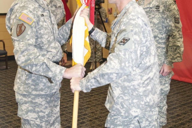 Brig. Gen. Lewis Irwin, outgoing commander, accepts the guidon from Command Sgt. Maj. Paul Yingst, senior enlisted advisor, during the 926th Engineer Brigade change of command ceremony Nov. 23 at the Maj. David Moniac U.S. Army Reserve Center in Montgomery, Ala. (U.S. Army photo by Staff Sgt. Debralee Best)