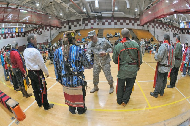 "FORT SAM HOUSTON, Texas -- Lt. Gen. Perry Wiggins greets and speaks with members of the Joint Base San Antonio - Fort Sam Houston Native American Indian Heritage Month Pow Wow during the celebration Nov. 15 at the Jimmy Brought Fitness Center. Wiggins is the commanding general of U.S. Army North (Fifth Army) and senior commander for Fort Sam Houston and Camp Bullis. ""Native Pride and Spirit: Yesterday, Today and Forever"" is this year's theme and speaks to how the contributions of the American Indians and their culture have woven into the fabric of our great nation and made us all a better unified country today. ""What a great chapter, in our history, (Native Americans) have played,"" Wiggins said. ""And today we get an opportunity to recognize … the great Americans who have stood side-by-side throughout history in defense of this great nation and who have great pride in the United States of America."" This year's celebratory event was brought to you by the JBSA-FSH Equal Opportunity Office."