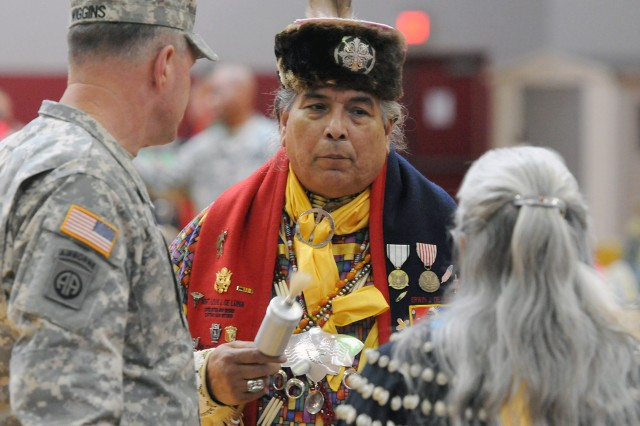 "FORT SAM HOUSTON, Texas -- Erwin De Luna (center), president of the United San Antonio Pow Wow, speaks with Lt. Gen. Perry Wiggins and another elder during the Joint Base San Antonio - Fort Sam Houston Native American Indian Heritage Month Pow Wow celebration Nov. 15 at the Jimmy Brought Fitness Center. Wiggins is the commanding general of U.S. Army North (Fifth Army) and senior commander for Fort Sam Houston and Camp Bullis. ""Native Pride and Spirit: Yesterday, Today and Forever"" is this year's theme and speaks to how the contributions of the American Indians and their culture have woven into the fabric of our great nation and made us all a better unified country today. This year's celebratory event was brought to you by the JBSA-FSH Equal Opportunity Office."