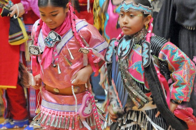 "FORT SAM HOUSTON, Texas -- Madison Banda and Dakota Osife, jingle-dress dancers of Navajo descent, both 8 years old, take part in the Joint Base San Antonio - Fort Sam Houston Native American Indian Heritage Month Pow Wow celebration Nov. 15 at the Jimmy Brought Fitness Center. ""Native Pride and Spirit: Yesterday, Today and Forever"" is this year's theme and speaks to how the contributions of the American Indians and their culture have woven into the fabric of our great nation and made us all a better unified country today."