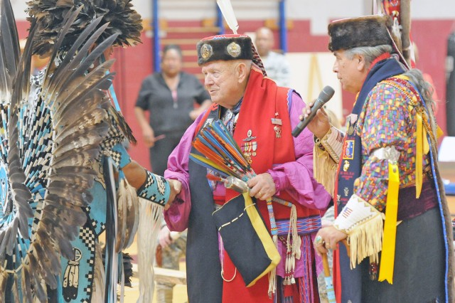 FORT SAM HOUSTON, Texas -- Retired Navy Chief Bill Bellinghausen (center) joins  Erwin De Luna (right), president of the United San Antonio Pow Wow, for one of the beginning ceremonies during the Joint Base San Antonio - Fort Sam Houston Native American Indian Heritage Month Pow Wow Nov. 15 at the Jimmy Brought Fitness Center. This year's celebratory event was brought to you by the JBSA-FSH Equal Opportunity Office.