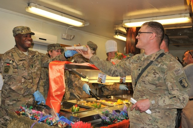 Command Sgt. Maj. Christopher T. Crawford serves Thanksgiving dinner to Spc. Victor W. Stephans, Nov. 28, 2013, at Bagram Airfield, Afghanistan. Defense Logistics Agency Troop Support Subsistence employees supplied more than 80,000 pounds of turkey in time for this year's Thanksgiving meal to Service members serving in West Africa, Afghanistan, Iraq and Kuwait.