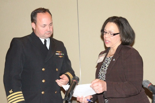 (Left) Navy Capt. Aaron Stanley, director of SDDC's Personal Property Directorate, and Jill Smith, chief of the Business Processes & Systems Integration Division within the directorate, review topics to be discussed during the recent Personal Property Forum held near Scott Air Force Base, Ill. Approximately 250 transportation service providers attended the conference.