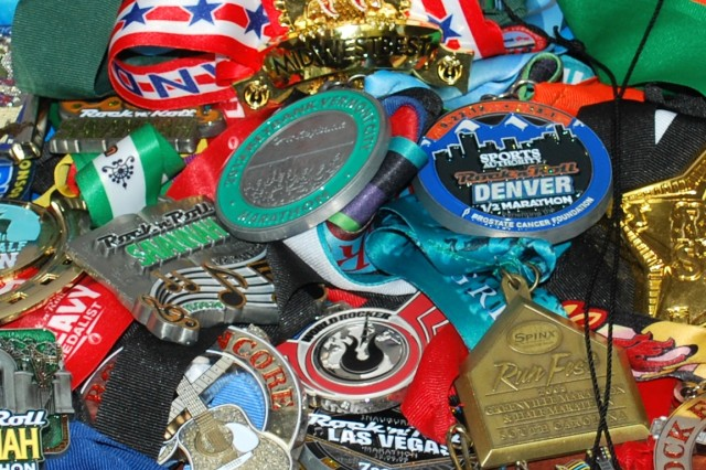 Anthony Anderson has amassed a large collection of marathon and half-marathon medallions.