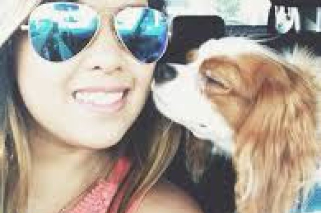 Survivor Selfie! Dallas nurse Nina Pham provides a photo of her and her pup Bentley. Texas Animal Health Commission experts retrieved blood, urine and feces samples from Bentley, who was quarantined in Texas. The samples were sent to the U.S. Army Medical Research Institute of Infectious Diseases' Special Pathogen Laboratory for diagnostic screening for the Ebola Zaire virus, using the standardized Ebola rRT-PCR protocol.