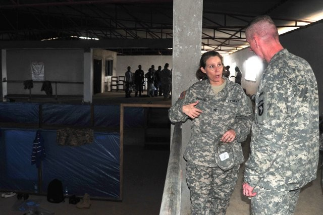 Col. Laura Favand, the chief of training, DoD Ebola Training Program, Joint Forces Command -- United Assistance, explains to Maj. Gen. Gary Volesky, the JFC-UA commander, what the Ebola treatment unit volunteers encounter during their medical training at the National Police Training Center, Paynesville, Liberia, Oct. 30, 2014. The participants work through various scenarios they may encounter while caring for Ebola and Ebola-symptomatic patients. The medical training is conducted by the DoD Ebola Training Team under the Joint Forces Command -- United Assistance, which supports the U.S. Agency for International Development in the effort to control the spread of Ebola