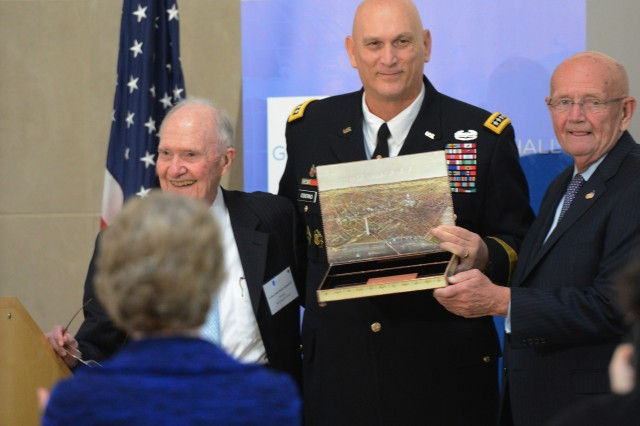 Former Army Chief of Staff Retired Gen. Gordon R. Sullivan (right) and former National Security Advisor and Retired Air Force Lt. Gen. Brent Scowcroft present the Andrew J. Goodpaster Award to Army Chief of Staff Gen. Ray Odierno, Dec. 5, 2014, at the Ronald Reagan Building, in Washington, D.C. Linda, Odierno's wife, looks on in the foreground.