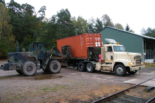 A forklift loads a container onto a flatbed truck operated by the Theater Logistics Support Center - Europe in support of Operation United Assistance. TLSC-E is providing valuable logistical support to operations in West Africa.  (Photo courtesy of the Theater Logistics Support Center - Europe, 21st TSC Public Affairs)