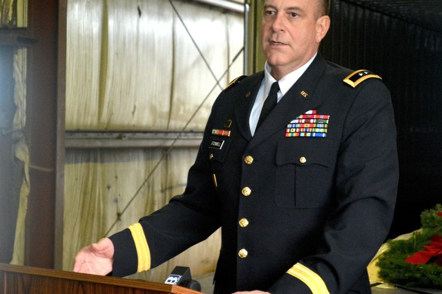 Maj. Gen. Kevin O'Connell, commanding general, U.S. Army Sustainment Command and Rock Island Arsenal, addresses members of Quad Cities media, Dec. 5, in a warehouse in Milan, Illinois, about a wreath-laying at Rock Island National Cemetery on Dec. 13. (Photo by Justin Graff, ASC Public Affairs Office)