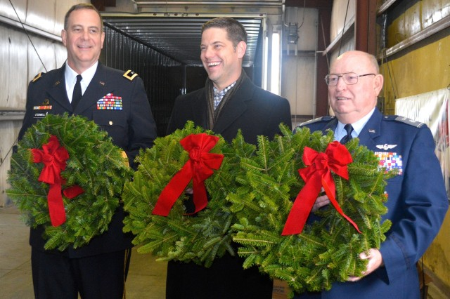 Maj. Gen. Kevin O'Connell, commanding general, U.S. Army Sustainment Command and Rock Island Arsenal, stands with Aaron Tennant, president and CEO of Tennant Truck Lines, Inc., and Lt. Col. Tom Nielsen, commander, Moline Civil Air Patrol, Dec. 5, during an event to promote a wreath-laying ceremony at Rock Island National Cemetery on Dec. 13. (Photo by Justin Graff, ASC Public Affairs Office)