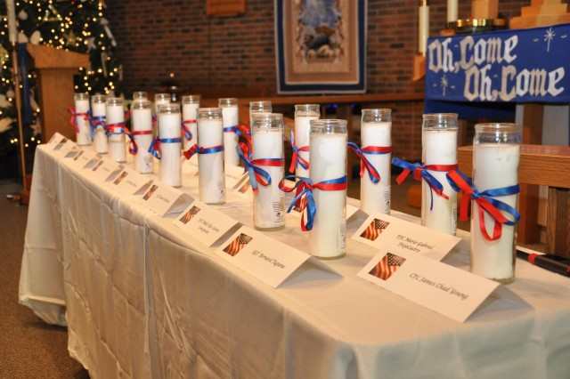 Candles representing the memory of lost Soldiers line a table at a remembrance ceremony at St. John Lutheran Church in Darien, Ill., Dec. 6 as part of the 416th Theater Engineer Command Family Programs.