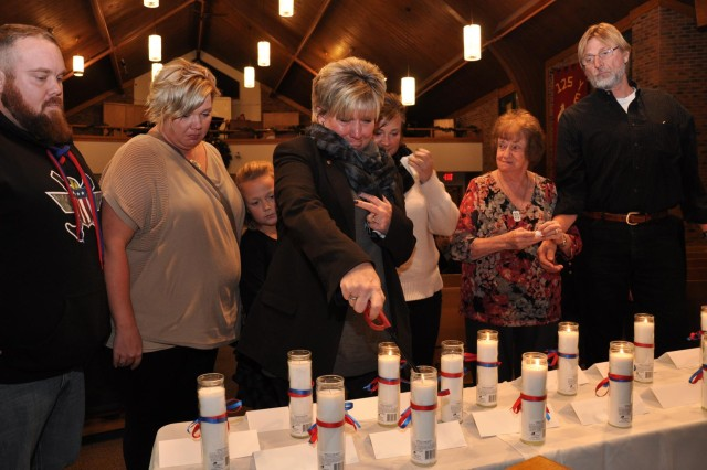Pfc. Aaron Toppen's family came to honor him and his service by lighting a candle recognizing him and his service at St. John Lutheran Church in Darien, Ill., as part of the 416th Theater Engineer Command Family Programs.