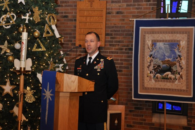"Lt. Col. Novak speaks at the remembrance ceremony pondering the service of these lost Soldiers, saying, ""We are honored to be able to walk a path that your loved ones have made smooth for us,"" at St. John Lutheran Church in Darien, Ill., as part of the 416th Theater Engineer Command Family Programs."