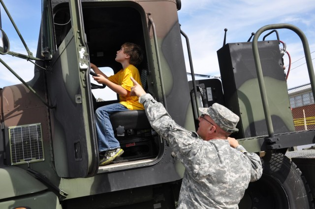Capt. Robert Mikyska, 416th Theater Engineer Command, points out a part of the M916 to a visitor at the Dupage County Safety Saturday demonstrating capabilities of first responders at the Dupage County Fairgrounds, Wheaton, Ill., Sept. 27.