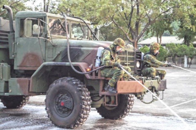 The Taiwan Army practices using decontamination equipment for mosquito control. The truck was originally designed to spray a sterilizing solution, but adapted to spray pesticide.