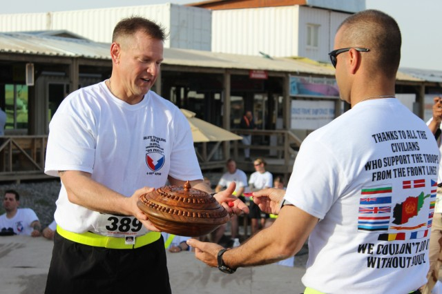 "Members of the 401st Army Field Support Brigade, Kandahar, Kuwait thank their civilian teammates with a ""Salute to Civilians"" fun run and recognition ceremony."