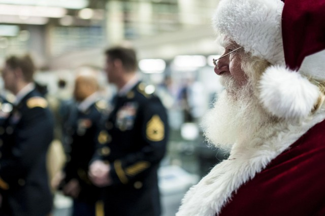 Santa Claus (John Sullivan, a former National Guardsman) waits alongside military service members before the Snowball Express farewell ceremony at the Chicago O'Hare International Airport, Dec. 11. Snowball Express is a nonprofit organization sponsored by American Airlines that organizes an all-expenses-paid trip for children and spouses who have lost a fallen military hero to offer them support, activities, healing and positive memories during the December holiday season. (U.S. Army photo by Sgt. 1st Class Michel Sauret)