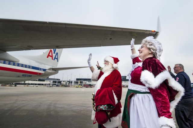 Mr. and Mrs. Santa Claus wave goodbye to Gold Star family members during a Snowball Express farewell ceremony at the Chicago O'Hare International Airport, Dec. 11. Snowball Express is a nonprofit organization sponsored by American Airlines that organizes an all-expenses-paid trip for children and spouses who have lost a fallen military hero to offer them support, activities, healing and positive memories during the December holiday season. (U.S. Army photo by Sgt. 1st Class Michel Sauret)
