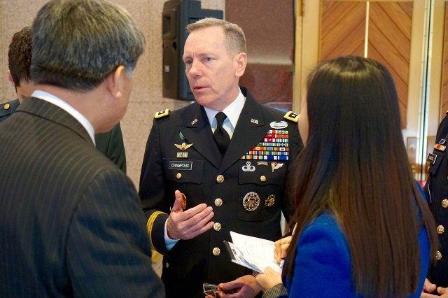 Eighth Army Commander Lt. Gen. Bernard S. Champoux socializes with local dignitaries during a reception prior to the 7th Annual Korea-America Friendship Holiday Concert at the Seoul Performing Arts Center Dec. 14, 2014.