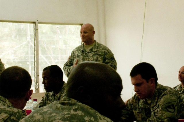 Maj. Alexander Ragan, Behavior Health officer for the 36th Engineer Brigade, based at Fort Hood, Texas, speaks to a group of Soldiers about the importance of monitoring their overall health during the deployment to Liberia. Operation United Assistance is a Department of Defense operation in Liberia to provide logistics, training and engineering support to U.S. Agency for International Development-led efforts to contain the Ebola virus outbreak in western Africa.