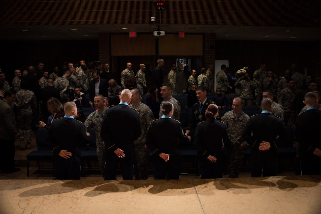 The Military District of Washington Sergeant Audie Murphy Club's six newest members are congratulated during a ceremony, Dec. 11, 2014, at the U.S. Army Band's Brucker Hall on Joint Base Myer Henderson Hall, Va.