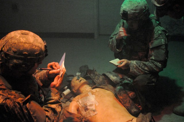 Service members respond to a simulated casualty inside one of the MSTC's dark, loud, smoke-filled validation rooms, which are designed to mimic the chaos of war.