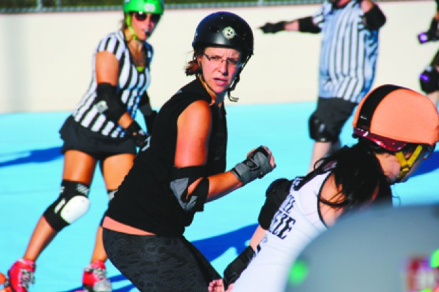 Military spouse gives roller derby a whirl