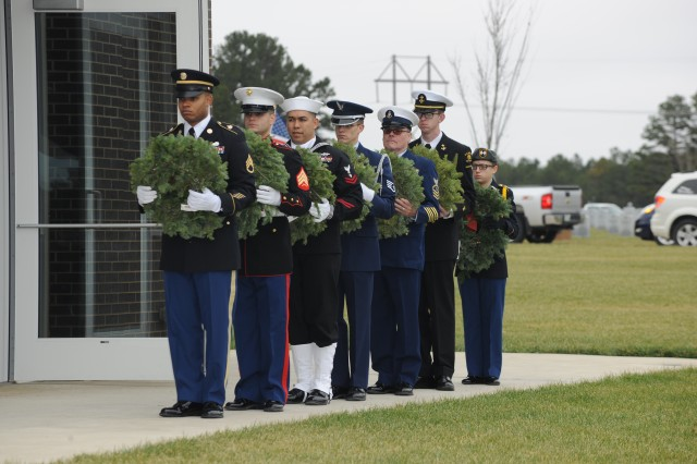 The Fort Leonard Wood Joint Services Color Guard participate in the Wreaths Across America ceremony Saturday.