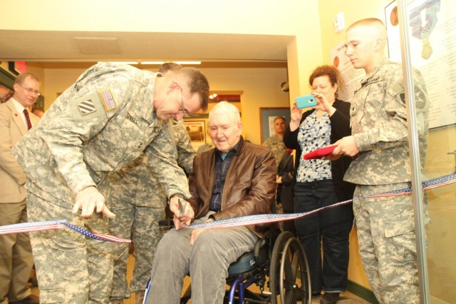 Maj. Gen. Terry Ferrell, Commander, 7th Infantry Division (left) joins retired Lt. Gen. William H. Harrison for a ribbon-cutting ceremony to open a 7th Inf. Div. historical exhibit at the Lewis Army Museum, Dec. 12.