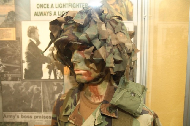 The Lewis Army Museum exhibit for 7th Infantry Division includes displays of its historical artifacts, including uniforms characteristic of the division light infantry Soldiers. The gallery opened Dec. 12 at Joint Base Lewis-McChord, Wash.