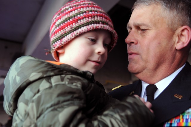 Lt. Gen. David Halverson spends time with Seth Parrish, the gold star son of fallen Sgt. Maj. Harry Lewis Parrish, at the 115th Army-Navy football game Dec. 13, 2014, at M&T Bank Stadium in Baltimore.