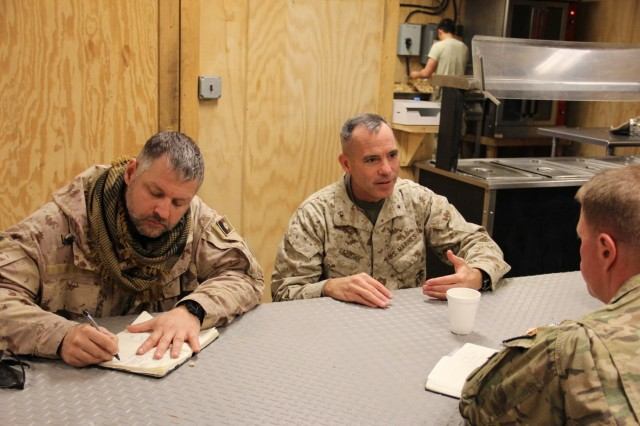 U.S. Marine Corps Brig. Gen. Paul Lebedine (center), the Kabul-based Advise and Assist Cell Commander, speaks to U.S. Army Brig. Gen. Christopher Bentley (right), the Train, Advise, Assist Command - East Commander, and Canadian Army Lt. Col. Christopher Comeau, the AAC - Southeast Liaison Officer (left), during an expeditionary advisory package to 203rd Afghan National Army Corps in southeastern Afghanistan Dec. 10, 2014. The meeting was the first opportunity for the generals to discuss the transition from TAAC-E's level-two advising of Afghan security forces in southeastern Afghanistan to level-three advising by the AAC in January 2015. (U.S. Army photo by Capt. Jarrod Morris, TAAC-E PAO)(Released)