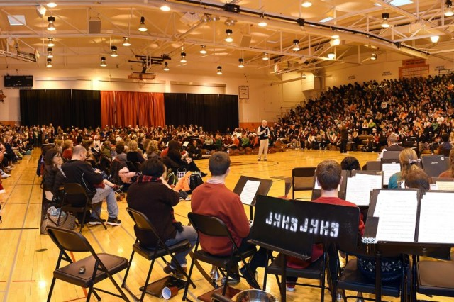 Two thousand John Hersey High School students and staff members wait for the arrival of retired Army Sgt. Jason Smith, wounded warrior; during an honor for Smith at John Hersey High School, Dec. 19. Smith was invited to JHHS to be honored and presented with a ceremonial check representing the $18,000 that was raised to build a home for him and his family.