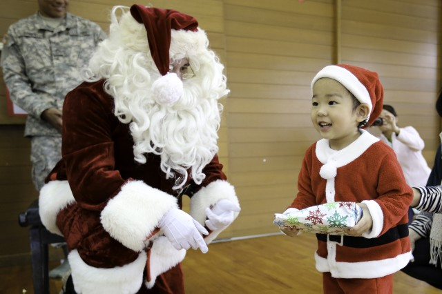Santa visited the Tsukushi-En special needs school in Okinawa City Dec. 17 along with several Soldiers from the U.S. Army Garrison -- Okinawa Better Opportunities for Single Soldiers program.