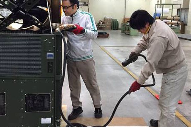 Contractors from the Army Field Support Battalion-Northeast Asia, prepare an Environmental Control Unit at Sagami General Depot, Japan, for issue to the 47th Combat Support Hospital in support of Exercise Keen Sword 15. (Photo by John Warns, AFSBn-NEA)