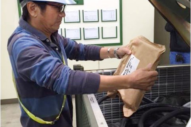 A contractor from Army Field Support Battalion-Northeast Asia, inventories Basic Issue Items for an Environmental Control Unit at Sagami General Depot, Japan, for issue to the 47th Combat Support Hospital in support of Exercise Keen Sword 15. (Photo by John Warns, AFSBn-NEA)