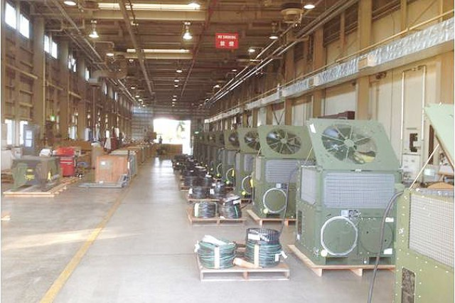 Environmental Control Units and Power Distribution Panels are lined up in the Army Field Support Battalion-Northeast Asia's maintenance facility at Sagami General Depot, Japan, in preparation for issue to the 47th Combat Support Hospital in support of Exercise Keen Sword 15. (Photo by John Warns, AFSBn-NEA)