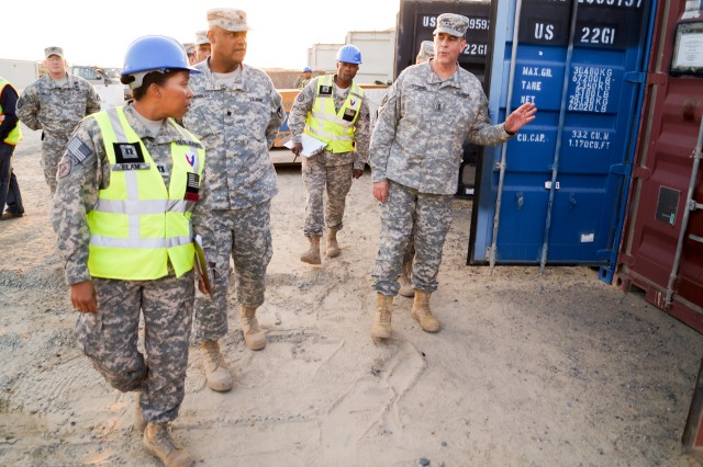 Maj. Gen. Kevin G. O'Connell, commanding general, Army Sustainment Command, leads a discussion with Cpt. Beatrice Elam, Army Field Support Battalion-Kuwait supply operations officer-in-charge, during a Lot 30 container briefing at Camp Arifjan, Kuwait, Dec. 17. (Photo by Sgt. William Taylor, 402nd Army Field Support Brigade Public Affairs)