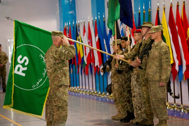 Command Sergeant Major, Delbert D. Byers, salutes during the presentation of the Resolute Support Colors at the Change of Mission Ceremony in Kabul. The North Atlantic Treaty Organization (NATO) Change of Mission Ceremony from International Security Assistance Force (ISAF) to Resolute Support Mission was held, Dec. 28, 2014, in Kabul, Afghanistan.