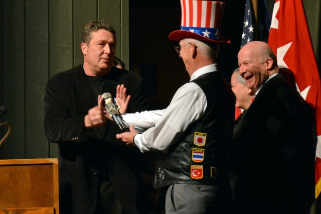 Phillip Otto, left, artistic director of the Huntsville Ballet Company, presents a military-themed nutcracker to David Carney, who gave the welcome and introduction at Military Appreciation Night.